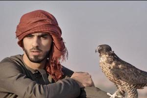 Omar Burkan Al-Gala with falcon